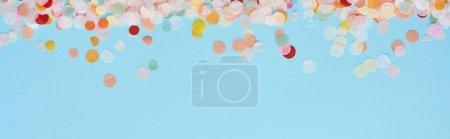 Foto de Panoramic shot of colorful confetti on blue - Imagen libre de derechos