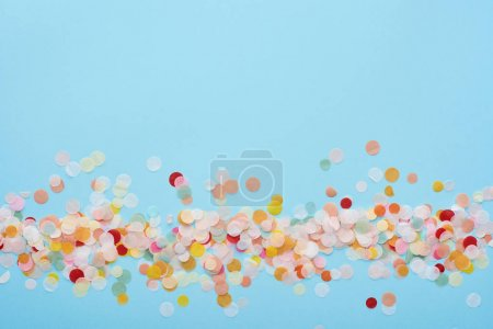 Photo for Top view of colorful confetti on blue - Royalty Free Image