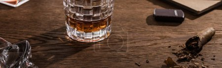 Photo for Glass of brandy with cigar, lighter and book on wooden table, panoramic shot - Royalty Free Image