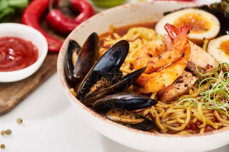 Photo for Close up view of spicy seafood ramen with mussels and shrimps in bowl - Royalty Free Image