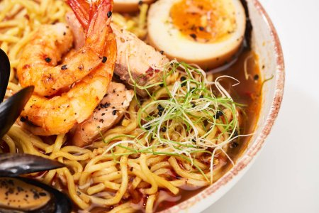Photo for Close up view of spicy seafood ramen in bowl - Royalty Free Image