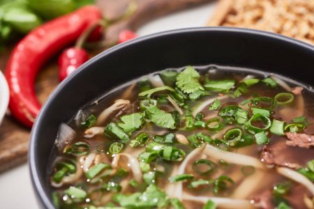 Photo for Close up view of pho with noodles, meat, cilantro and green onion in bowl - Royalty Free Image