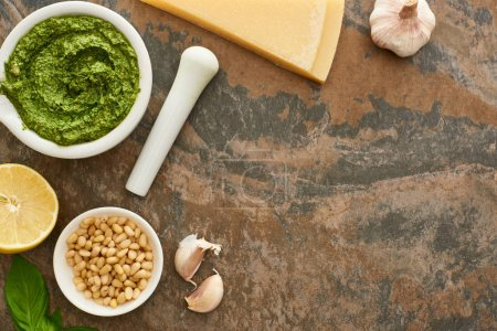 top view of pesto sauce and ingredients on stone surface