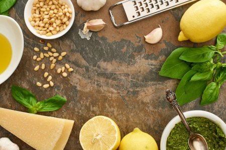 Photo for Top view of pesto sauce and ingredients on stone surface - Royalty Free Image