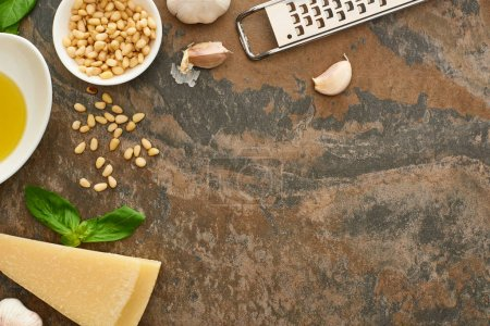 Photo for Top view of pesto sauce ingredients and grater on stone surface - Royalty Free Image