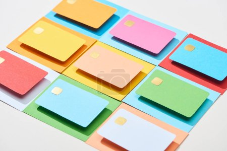 Photo for Multicolored empty credit cards on grey background - Royalty Free Image