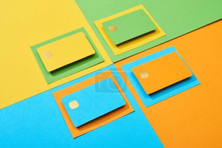 Photo for Empty credit cards on green, orange, blue and yellow background - Royalty Free Image