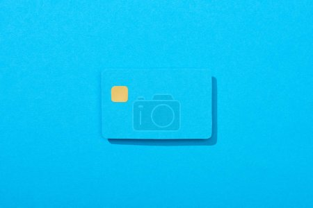 Photo for Top view of colorful empty credit card on blue background - Royalty Free Image