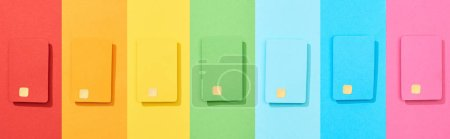 Photo for Top view of multicolored empty credit cards on rainbow background, panoramic shot - Royalty Free Image