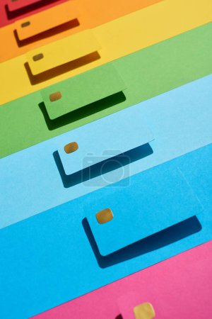 Photo for Multicolored empty credit cards on rainbow background - Royalty Free Image