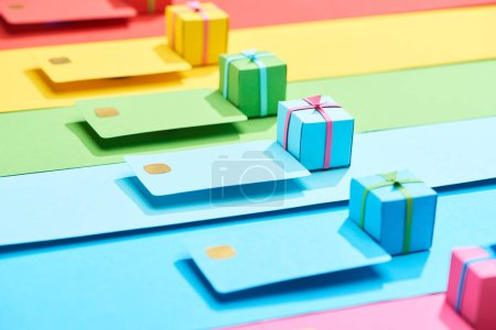 Photo for Multicolored empty credit cards and gift boxes on rainbow background - Royalty Free Image