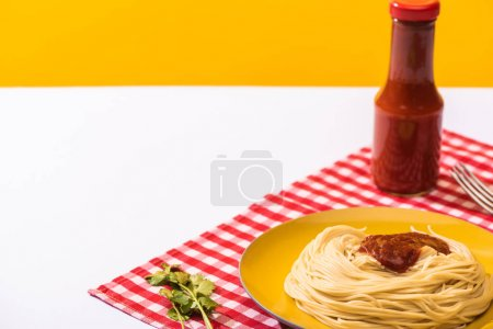 Photo for Spaghetti with tomato sauce beside cilantro on white surface on yellow background - Royalty Free Image