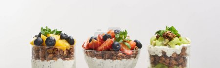 Photo for Fresh granola with fresh fruits and berries isolated on grey - Royalty Free Image