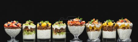 Photo for Fresh granola with fresh fruits and berries isolated on black, panoramic shot - Royalty Free Image