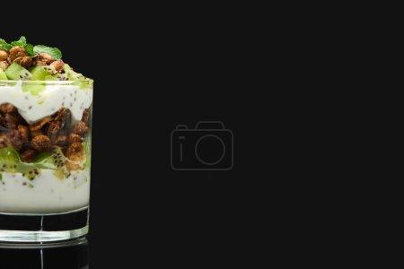 Photo for Fresh granola with kiwi and yogurt isolated on black - Royalty Free Image