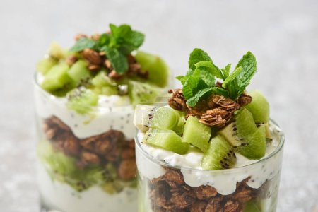 Photo for Selective focus of fresh granola with kiwi and mint - Royalty Free Image