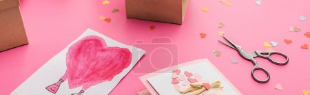 Photo for Valentines confetti, scissors, wrapping paper, gift boxes, greeting cards on pink background, panoramic shot - Royalty Free Image