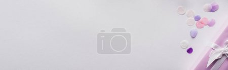 Photo for Top view of valentines gift and confetti on white background, panoramic shot - Royalty Free Image