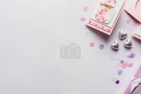 Photo for Top view of valentines decoration, greeting card, hearts, confetti on white background - Royalty Free Image