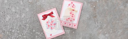 Photo for Top view of valentines greeting cards on concrete grey background, panoramic shot - Royalty Free Image