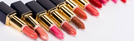 Photo for Selective focus of assorted lipsticks in luxury tubes on white background, panoramic shot - Royalty Free Image
