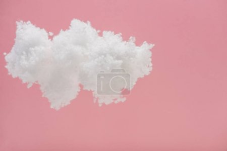 Photo for White fluffy cloud made of cotton wool isolated on pink - Royalty Free Image