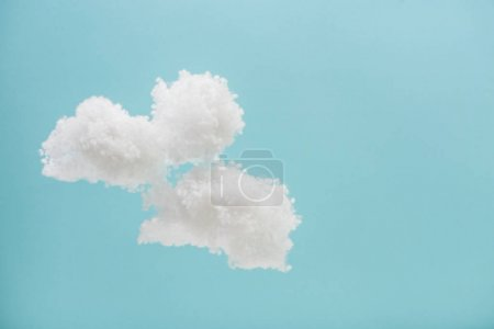 white fluffy clouds made of cotton wool isolated on blue background