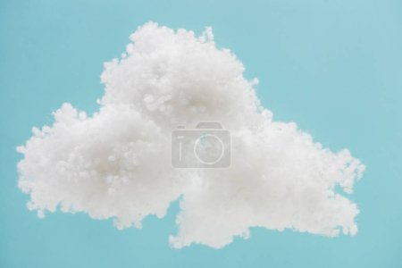 Photo for White fluffy cloud made of cotton wool isolated on blue background - Royalty Free Image