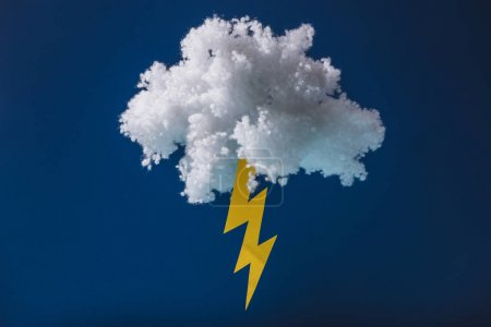 Photo for White fluffy cloud made of cotton wool with lightning isolated on dark blue - Royalty Free Image
