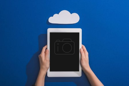 Photo for Cropped view of woman holding digital tablet near empty white paper cloud on blue - Royalty Free Image