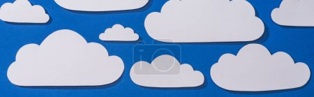 Photo for Top view of white paper cut clouds on blue background, panoramic shot - Royalty Free Image