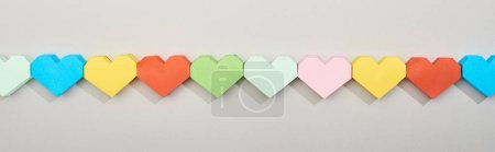 Photo for Top view of colorful heart shaped papers in line, panoramic shot - Royalty Free Image