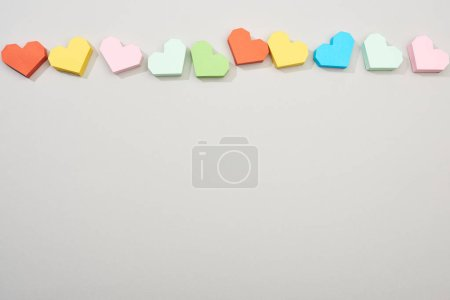Photo for Top view of colorful paper hearts on grey background with copy space - Royalty Free Image