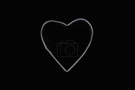 Photo for Top view of metal wire in heart shape isolated on black - Royalty Free Image