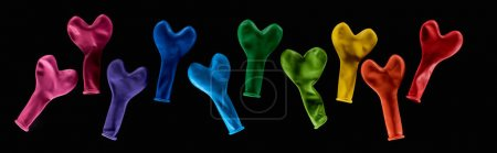 Photo for Top view of colorful rubber balloons in heart shape isolated on black, panoramic shot - Royalty Free Image