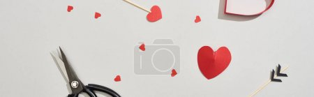 Photo for Top view of scissors, arrows and paper hearts on grey background, panoramic shot - Royalty Free Image