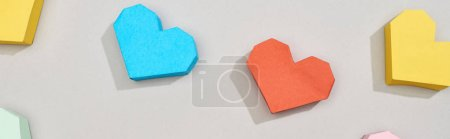 Photo for Top view of decorative heart shaped papers on grey background, panoramic shot - Royalty Free Image