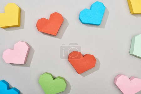Photo for Top view of festive heart shaped papers on grey background - Royalty Free Image