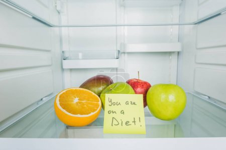 Photo for Card with you are on a diet lettering and fresh fruits in fridge - Royalty Free Image