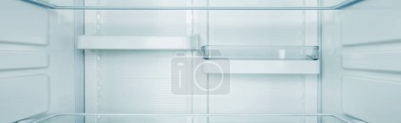 Photo for Panoramic shot of clean shelves of refrigerator - Royalty Free Image