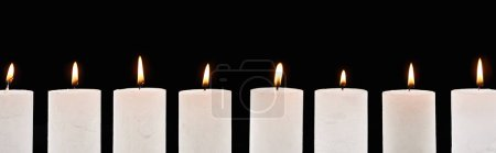 Photo for Burning white candles glowing in line isolated on black, panoramic shot - Royalty Free Image