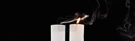 Photo for Burning and extinct white candles with smoke on black background, panoramic shot - Royalty Free Image