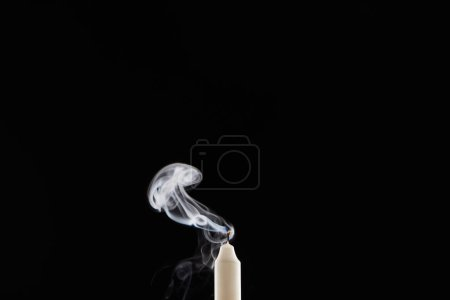 Photo for Extinct white candle with smoke on black background - Royalty Free Image