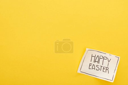 Photo for Top view of greeting card with happy Easter lettering on yellow colorful background - Royalty Free Image