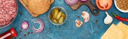Photo for Top view of fresh burger ingredients on blue textured surface, panoramic shot - Royalty Free Image