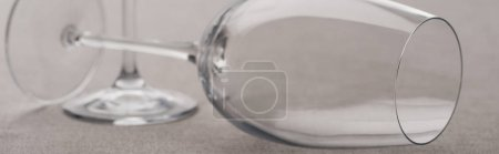Photo for Panoramic shot of clear wine glasses isolated on grey - Royalty Free Image