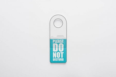 Photo for Top view of please do no disturb sign on white background - Royalty Free Image