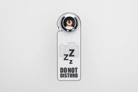 Photo for Do no disturb sign on handle with lock on white background - Royalty Free Image