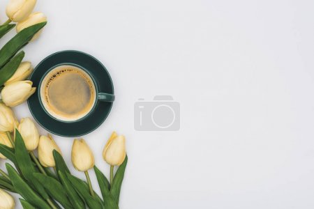 Photo for Top view of tulips and fresh coffee isolated on white - Royalty Free Image