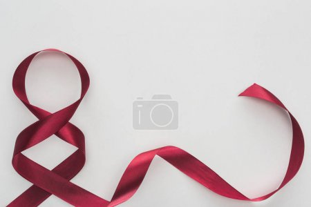 Photo for Top view of red silk ribbon as number 8 isolated on white - Royalty Free Image